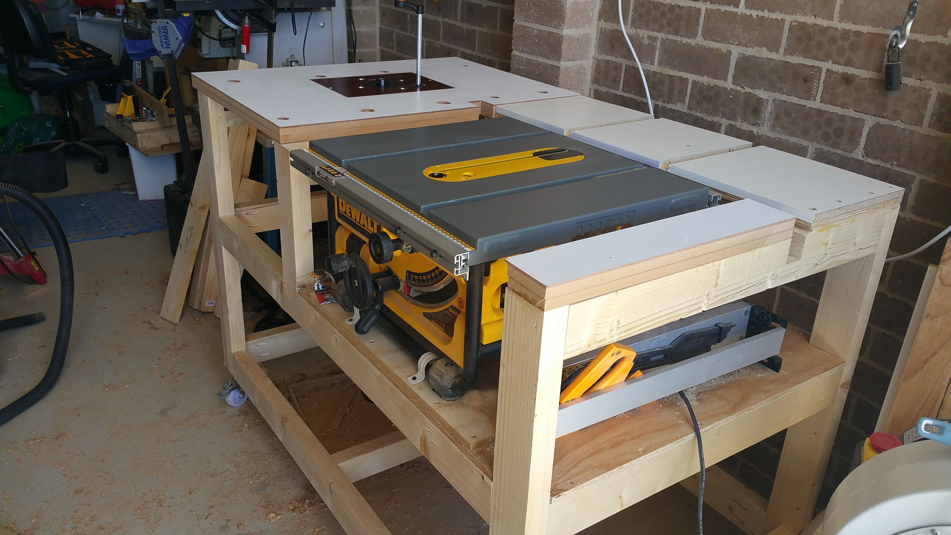 Workbench for DW745 with router table and outfeed. I made