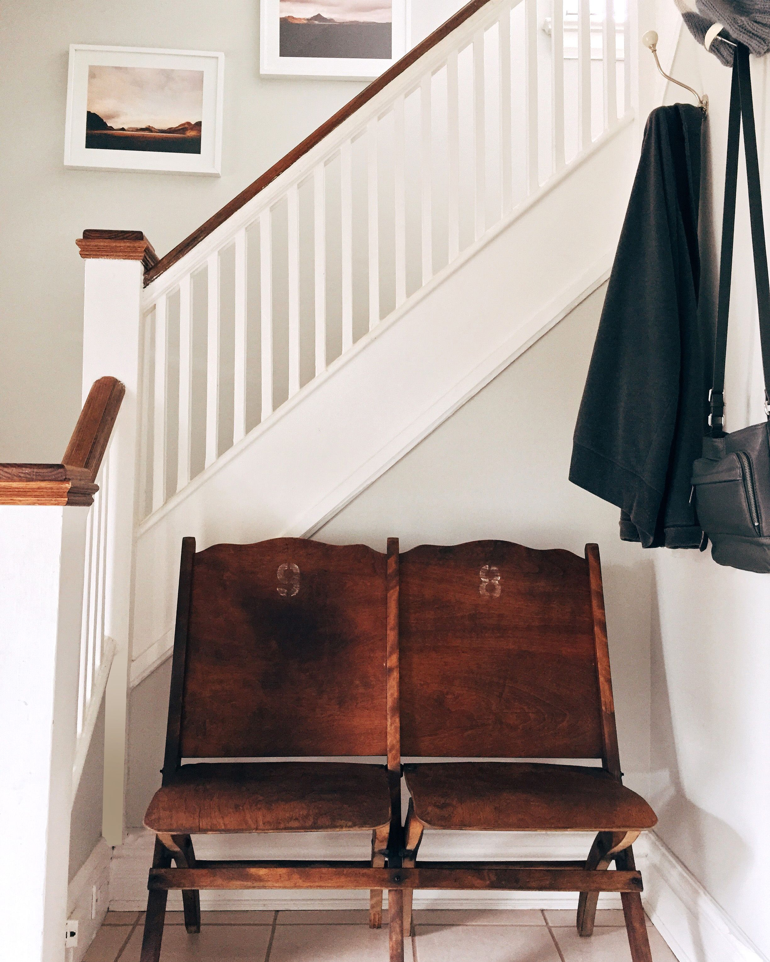 Home Theater Foyer : Entryway with vintage folding wood theatre seats hooks
