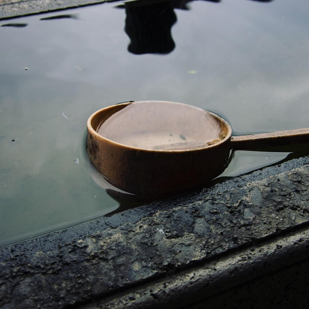 A lone ladle for washing hands (and mouth depending on personal preference) at an old shrine in Shizuoka, Japan. The water was extremely cold.