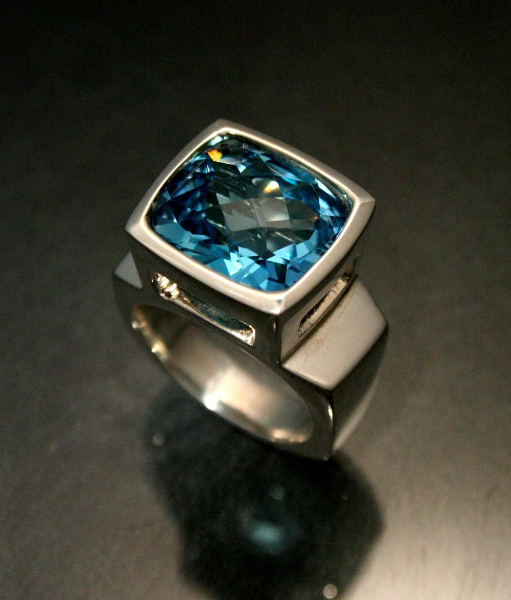 A Sterling Silver ring with a large cushion cut Blue Topaz by Art Metals Studio.