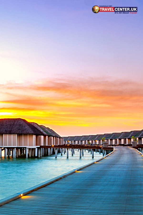 An amazing sunset panorama at the Maldives with overwater villas adding the luxury essence to the seascape with soft led lights under the colourful sky describes the pretty island nation. #travelmaldives #sea #luxurytravel #travelbeach #sunset #sunsetbeach #colourful #pretty #island #beachholiday #holidays #travel #itsallabouttravel #travelcenteruk