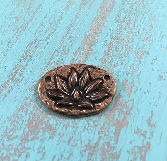 Lotus flower pendant, antiqued bronze. Enlightenment inscribed on backside.    -Purchase is for 1  -Size: Approx. 25.50 x 18mm    Solid Bronze