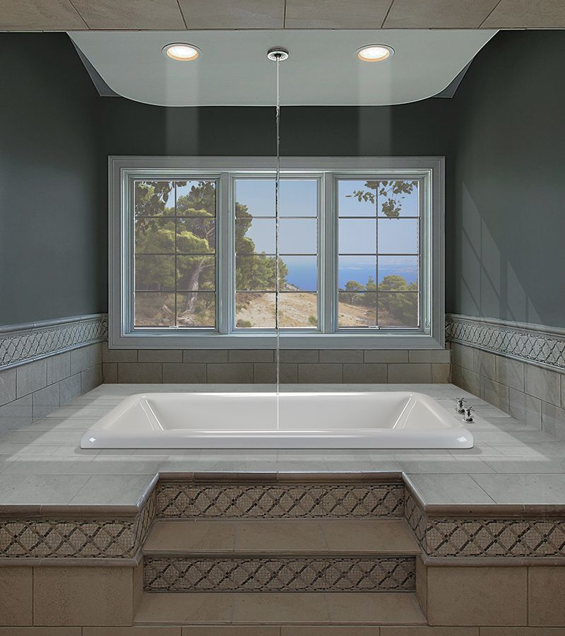 a tub filler from the ceiling to avoid the awkward position of a