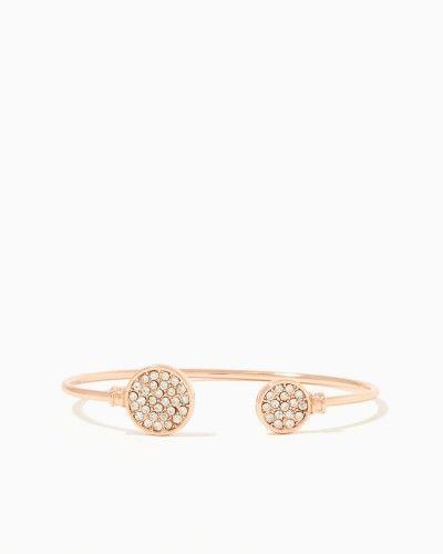 Shop for stackable fashion jewelry like this bracelet with pavé rounds (one large, one small) on a narrow metal band. Available in rose gold, gold and silver.