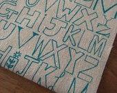 alphabetty - screenprinted fabric in orange zest on oatmeal. £5.00, via Etsy.