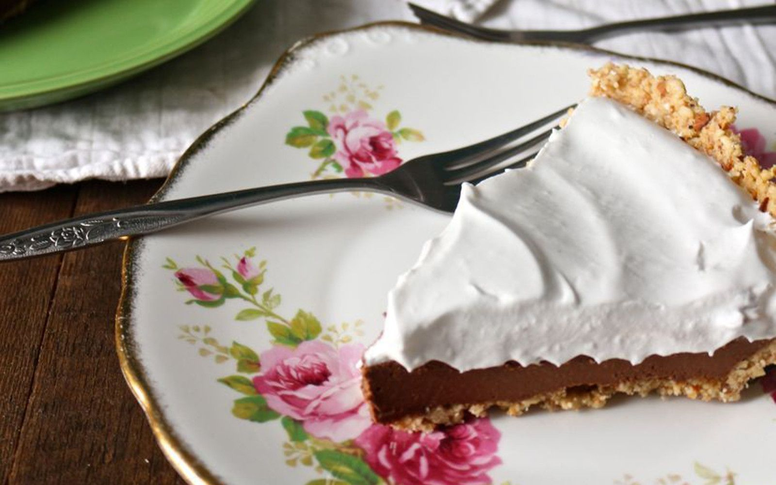 A hazelnut-almond shortbread crust layered with decadent chocolate filling and topped with airy whipped coconut cream.