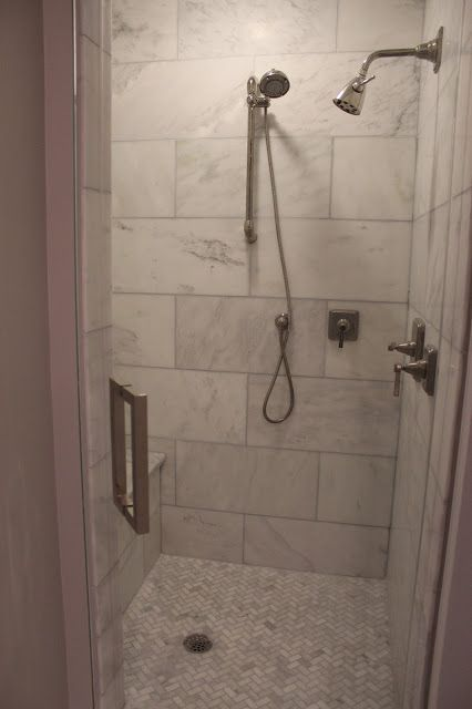 White Tiled Shower With Blue Glass Arabesque Tile Accent Wall And