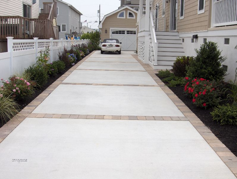 Like concrete and paver driveway or concrete with stamped for New concrete driveway