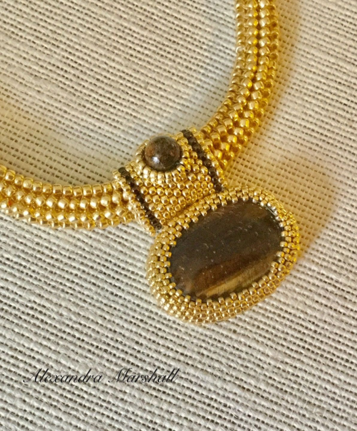 """Bold chunky Omega style necklace with interchangeable Tiger Eye and Bronzite beaded bail and cabochon pendant by Alexandra Marshall. Artisan crafted hook clasp enables adjustment from 16"""" to 20"""". #N2740-139."""