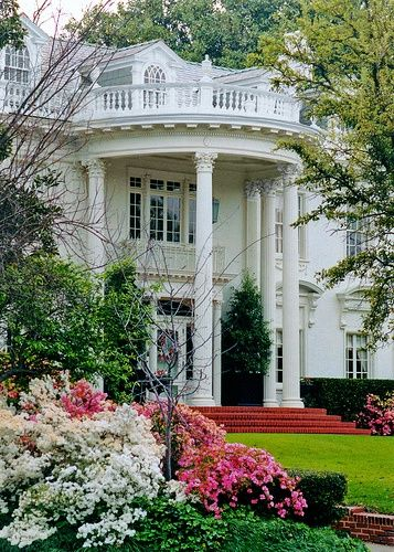 Beautiful white home with portico, columns, dormers Outside