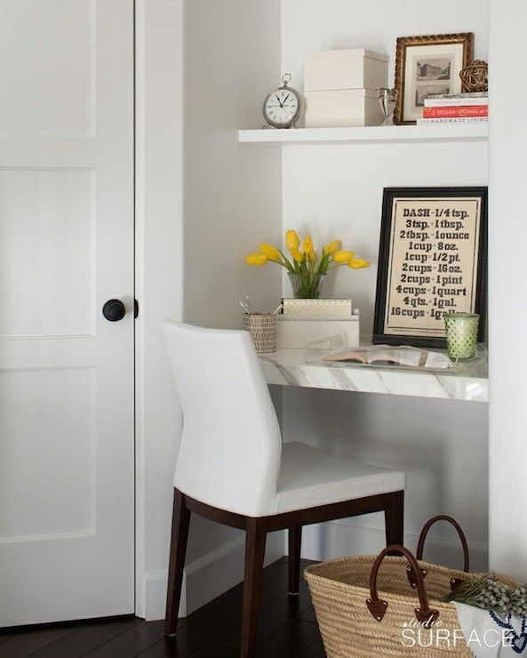 Kitchen Alcove Is Filled With White Floating Shelf Over Marble