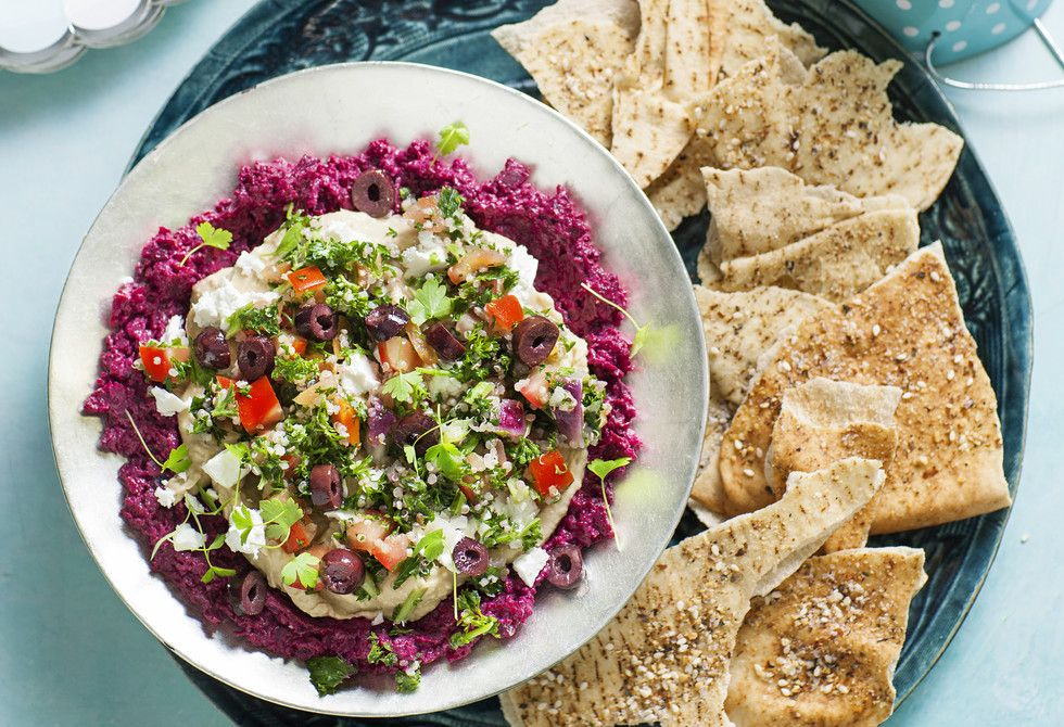 A beautiful layered dip recipe with hummus, tabouli and beetroot dip. Topped with feta and olives, it goes perfectly with zataar baked pita chips...