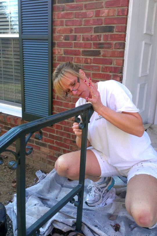 See our owner, Lynn, even gets down and dirty to get any job done! Here you can see her scraping and sanding a front hand rail of a customer's home. We do anything to go out of our way for our customers!  Need your home painted in the Kentuckiana area!? Call our office today for a free estimate!  P. (502) 836 0844