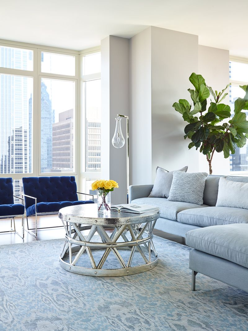Blue velvet lawson fenning chairs in high rise luxury condo blue velvet lawson fenning chairs in high rise luxury condo arteriors coffee table and stark geotapseo Image collections