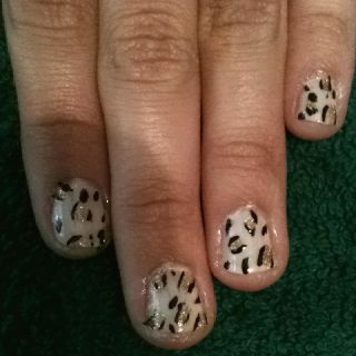 Cheetah nails!! Start with a light pink base coat. Add gold dots with a nail arts brush. Then place black lines next to dots.