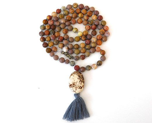 A personal favorite from my Etsy shop https://www.etsy.com/listing/253666376/handmade-108-knotted-mala-beads-rainbow