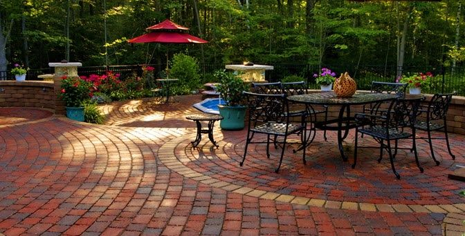 Brick Pavers Define The Outdoor Dining Area