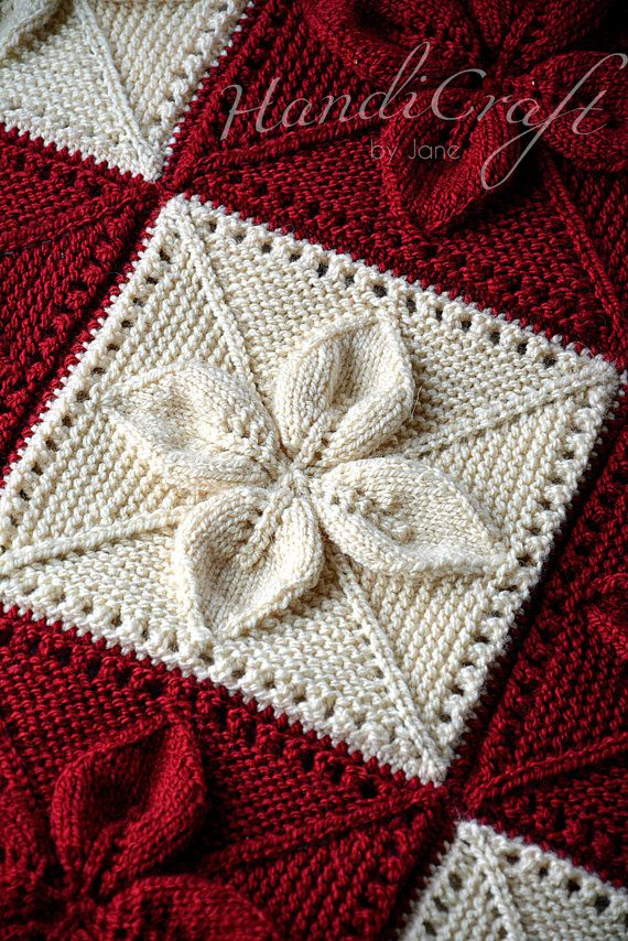 Knitted baby blanket. Red and beige handmade blanket for baby with leaf motifs. Soft, cozy and warm newborn gift