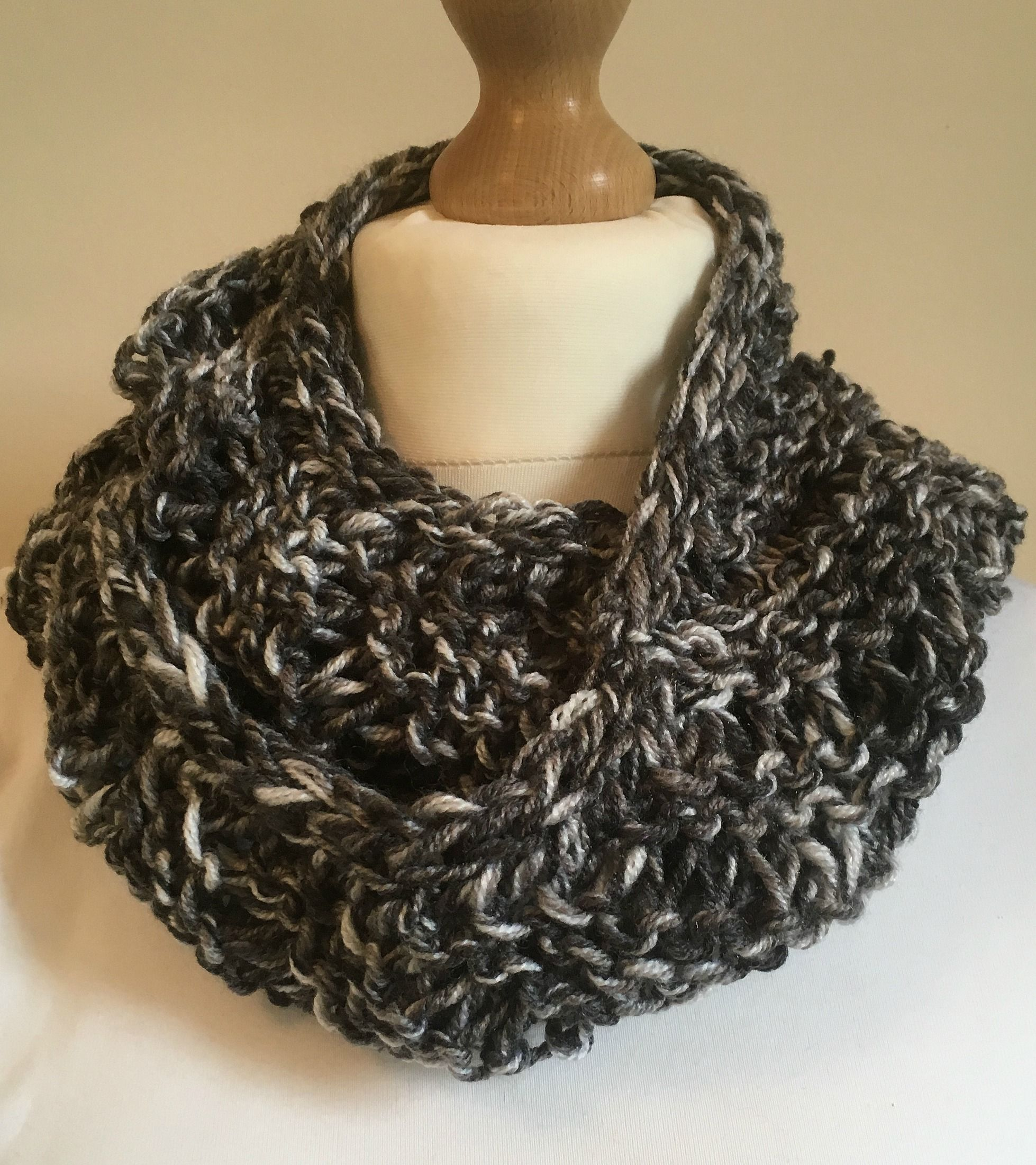 Unisex black and white hand knitted infinity scarf worked in unisex black and white hand knitted infinity scarf worked in chunky wool with acrylic yarn bankloansurffo Choice Image