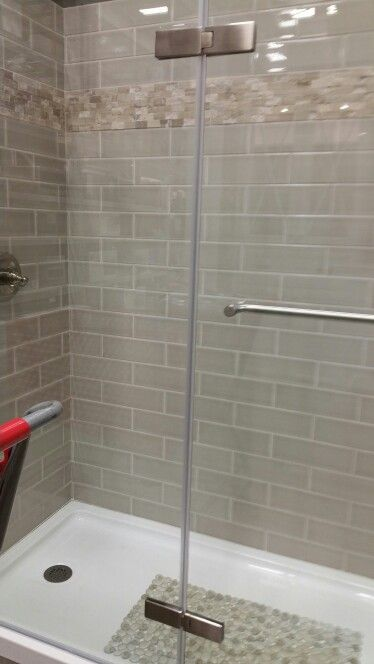 greige subway tile with beige stone