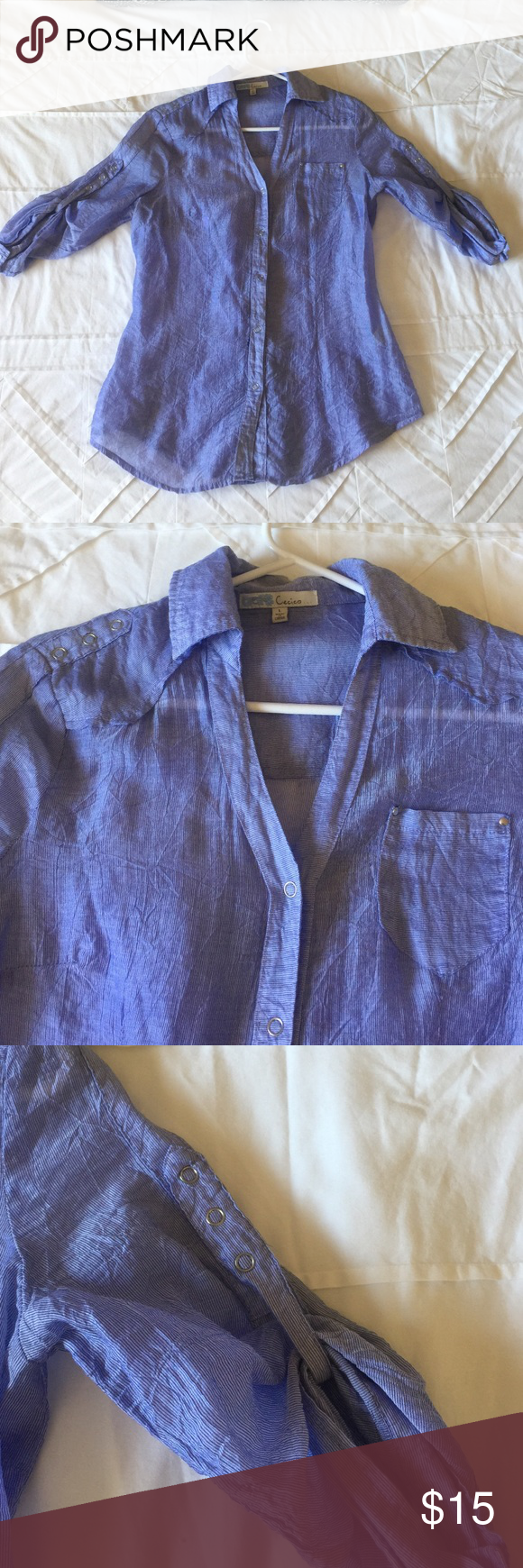 Three quarter length button up blouse Purple three quarter length snap button blouse.  Had three little button on back for a more fitted look.  One of the buttons is missing. Also has small hole in front near buttons. Tops Blouses