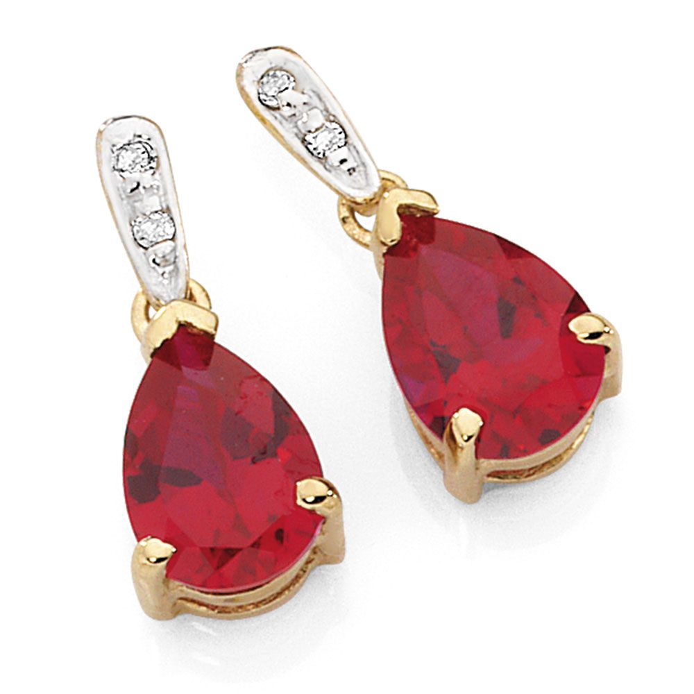 You Ll Fall In Love With These Beautiful Created Ruby And Diamond Earrings Set Yellow White Gold