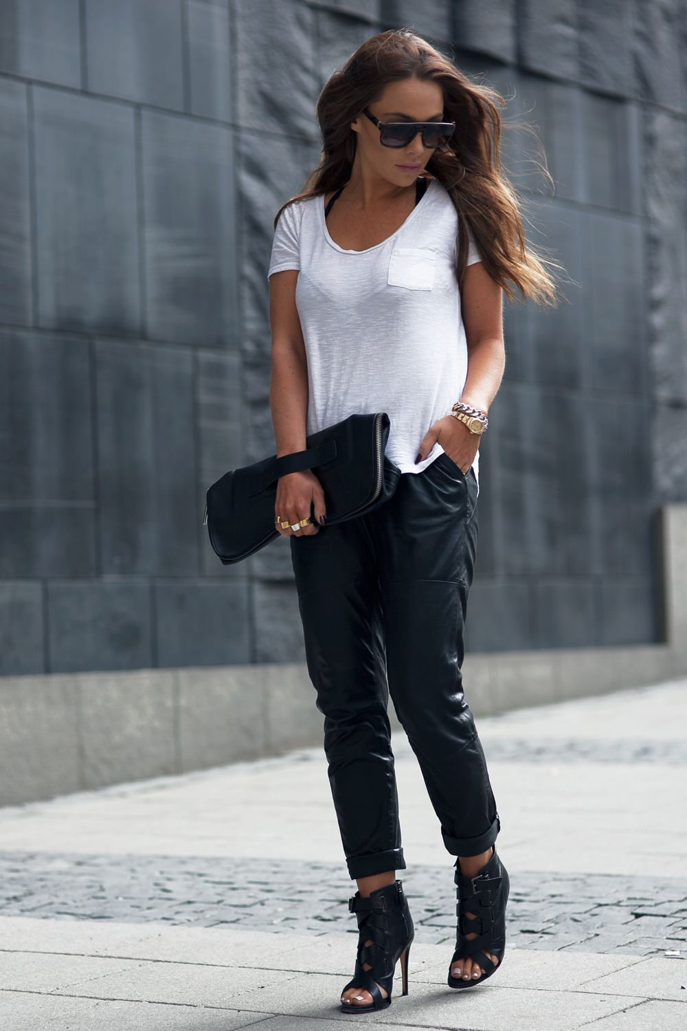 5ebd7683a4dde Black And White Fashion Trend: Johanna Olsson is wearing a white River  Island tee pair with black leather Designers Remix trousers, DVF heels and  a 3.1 ...