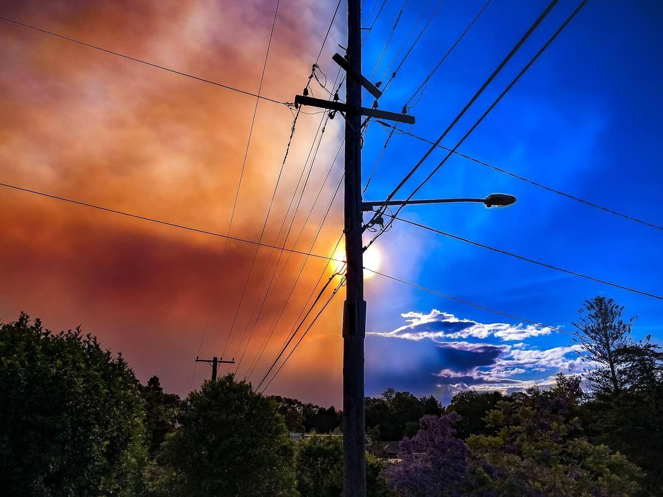 Caught the smoke as it was spreading over our suburb in