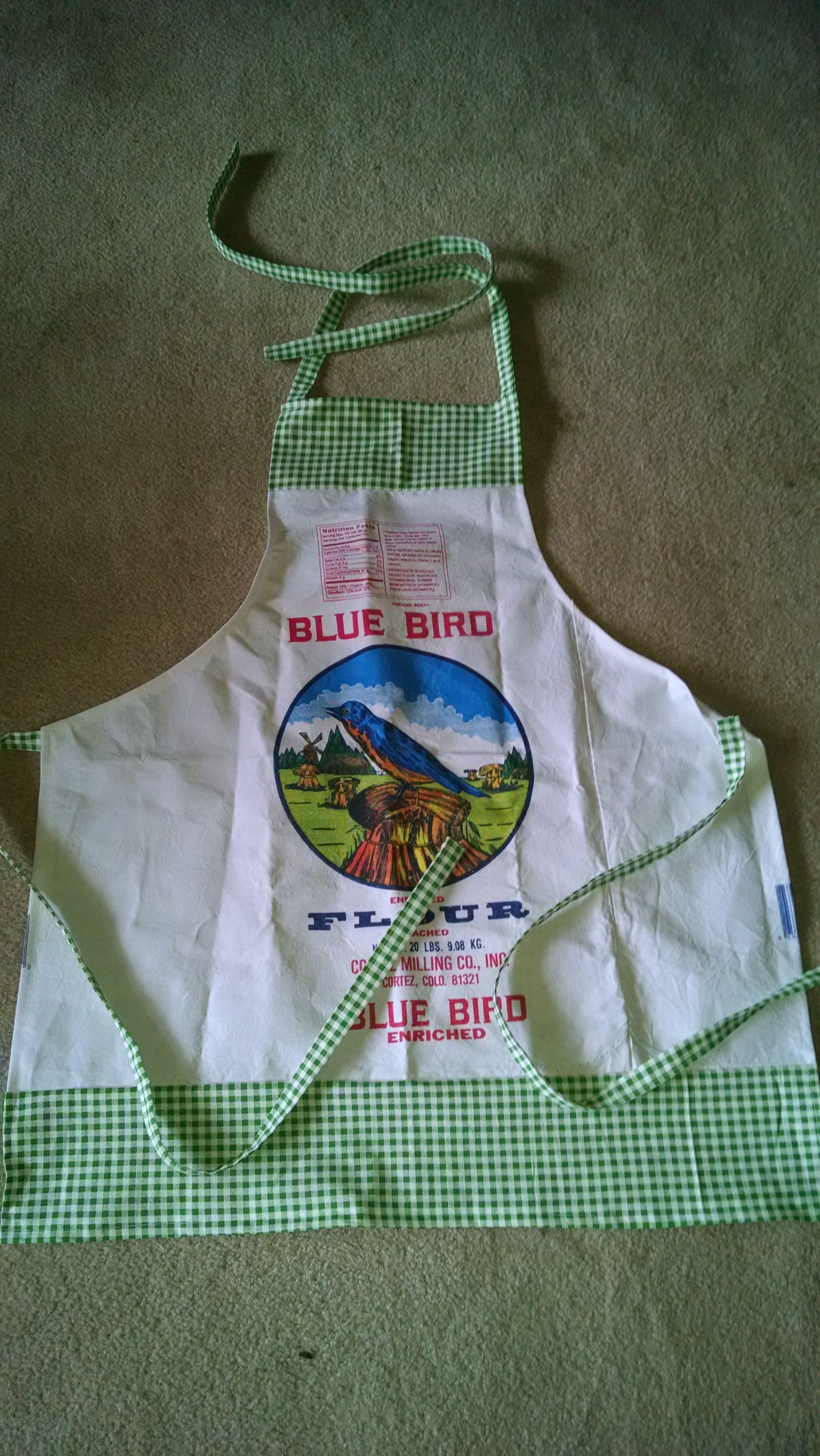 Blue bird flour sack apron with green gingham trim www.pietownaprons.com