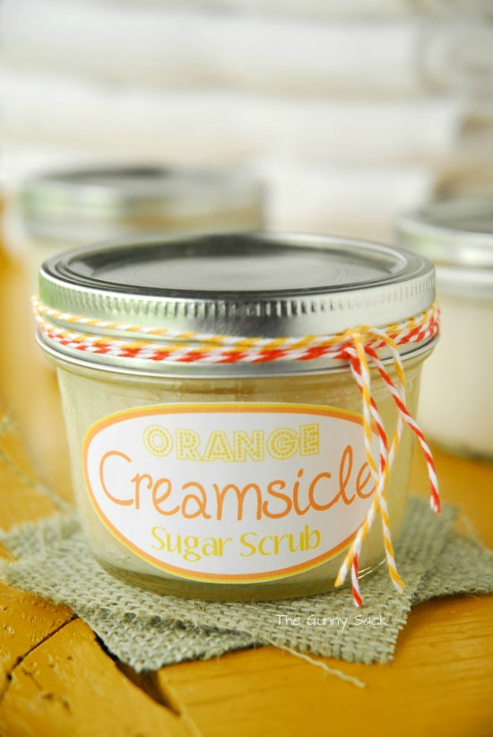 This pampering gift in a jar is an orange creamsicle sugar scrub recipe that uses coconut oil and smells good enough to eat. #sugarscrubrecipe