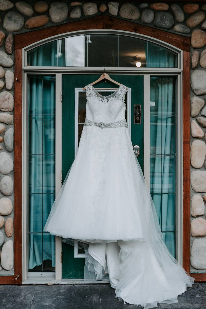 Teal and white wedding dresses  Caitlin u Craigus Canmore Wedding at the Cornerstone Theatre