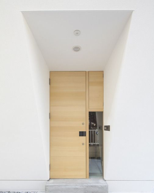 Entrance with simple structure on a pure white wall.