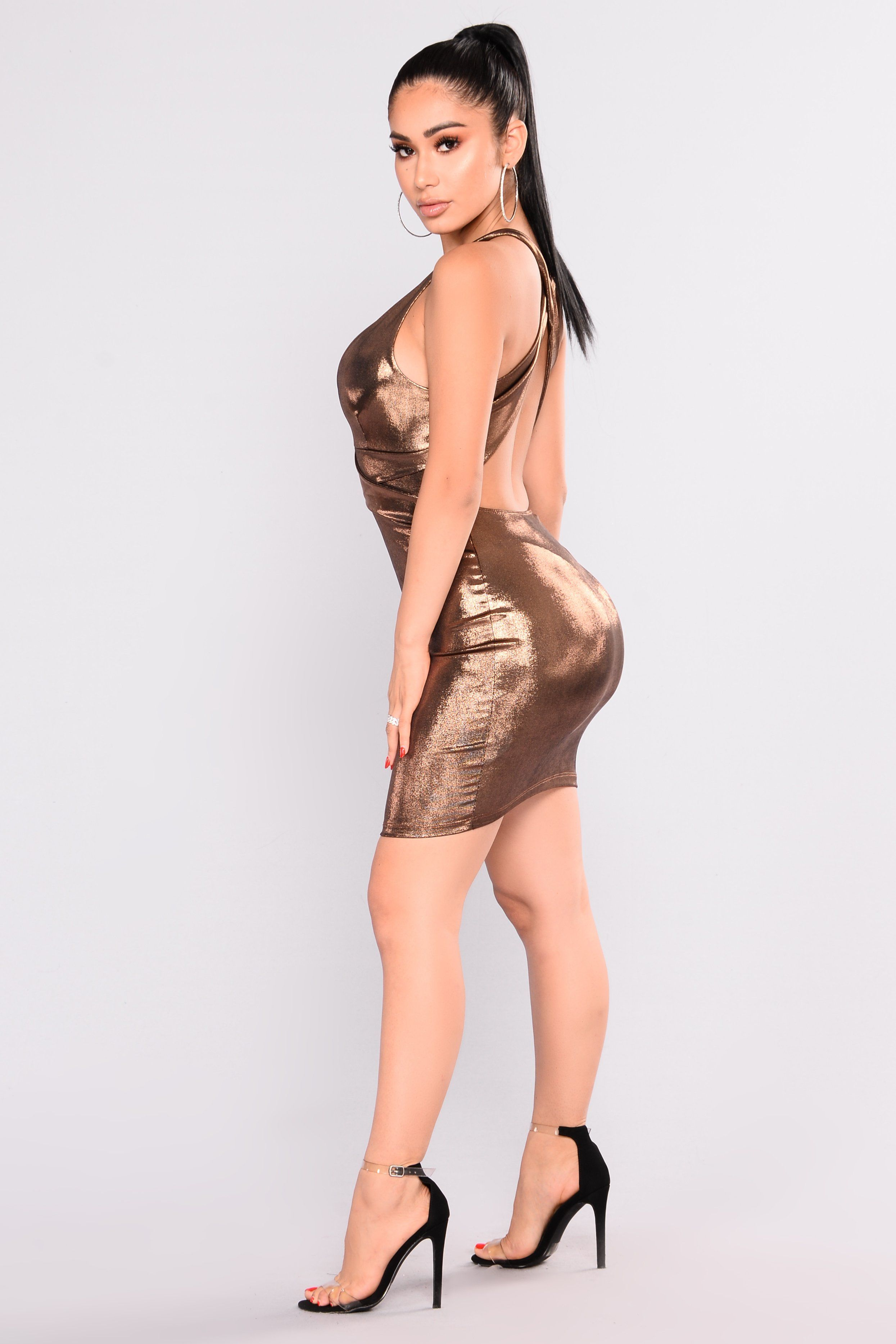 6a406dd4250 Available In Gold And Navy Slinky Foil Mini Length V Neck 94% Polyester 6%  Spandex Made in USA
