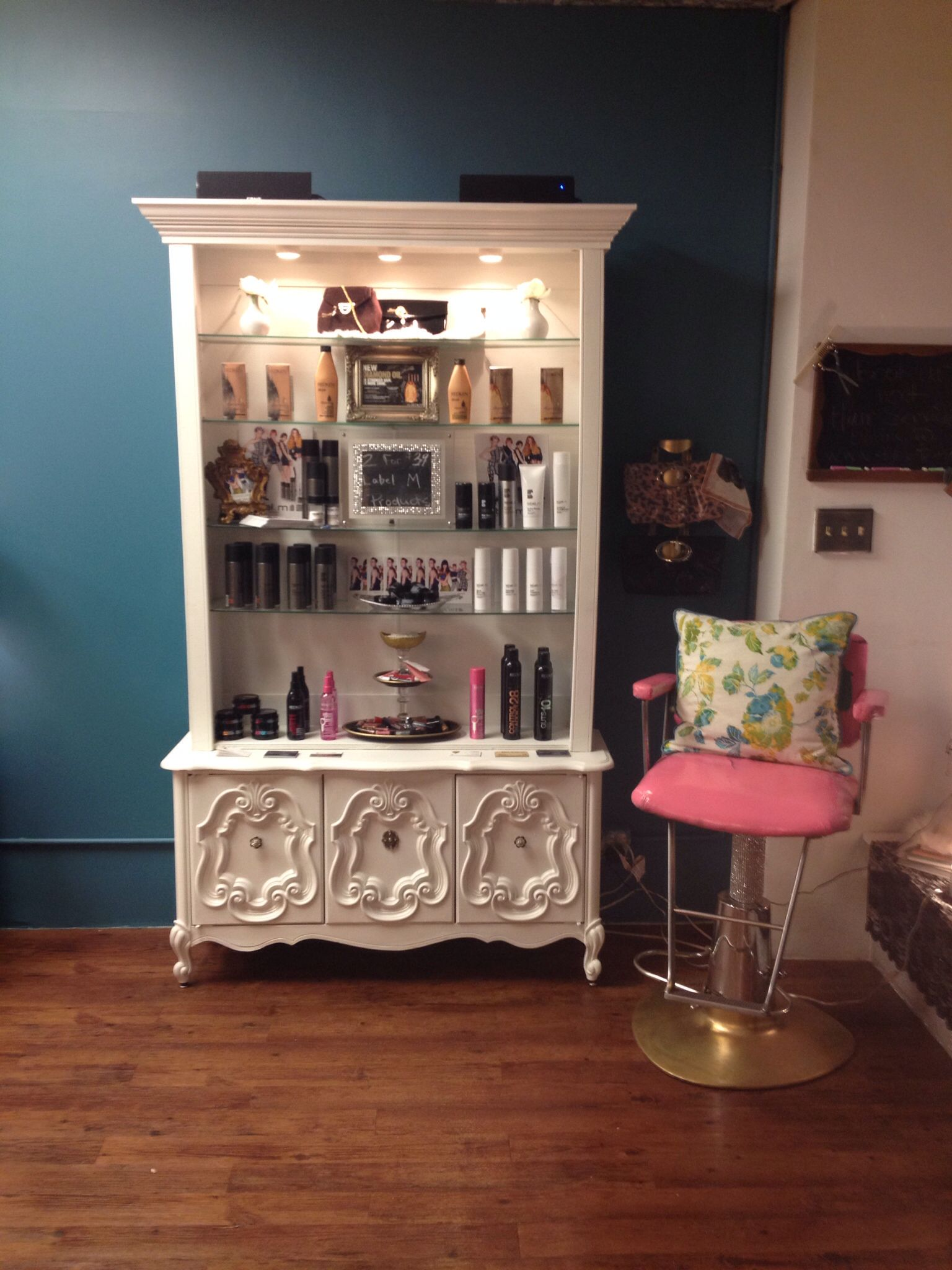 Salon Product Display And Cute Pink Chair