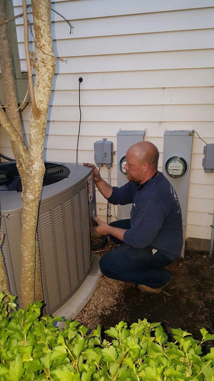 Scott finishing the installation of a Lennox XC14 air