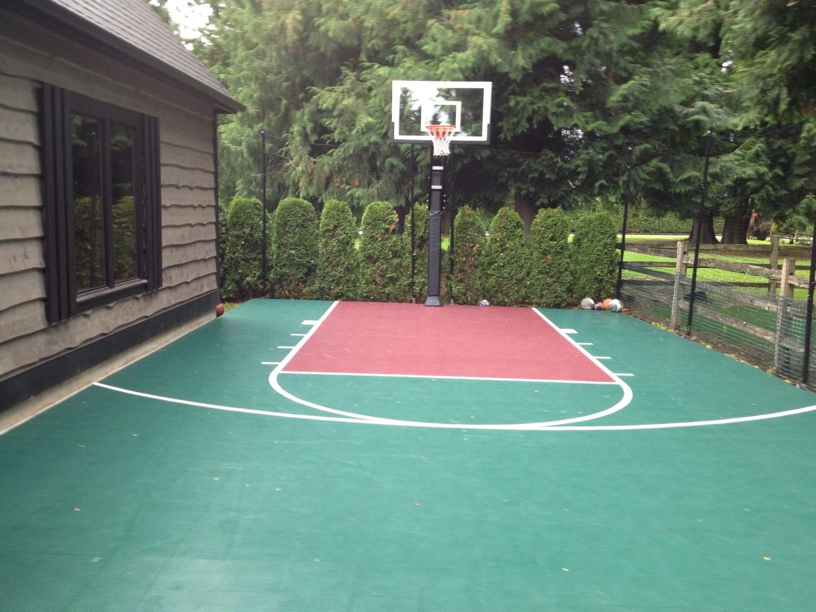 this custom teal colored court is home to a pro dunk gold basketball