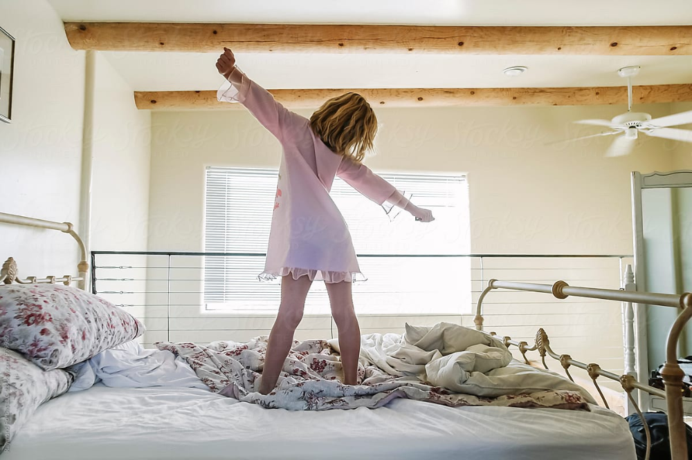 Stock Photo of young child yawning and stretching waking