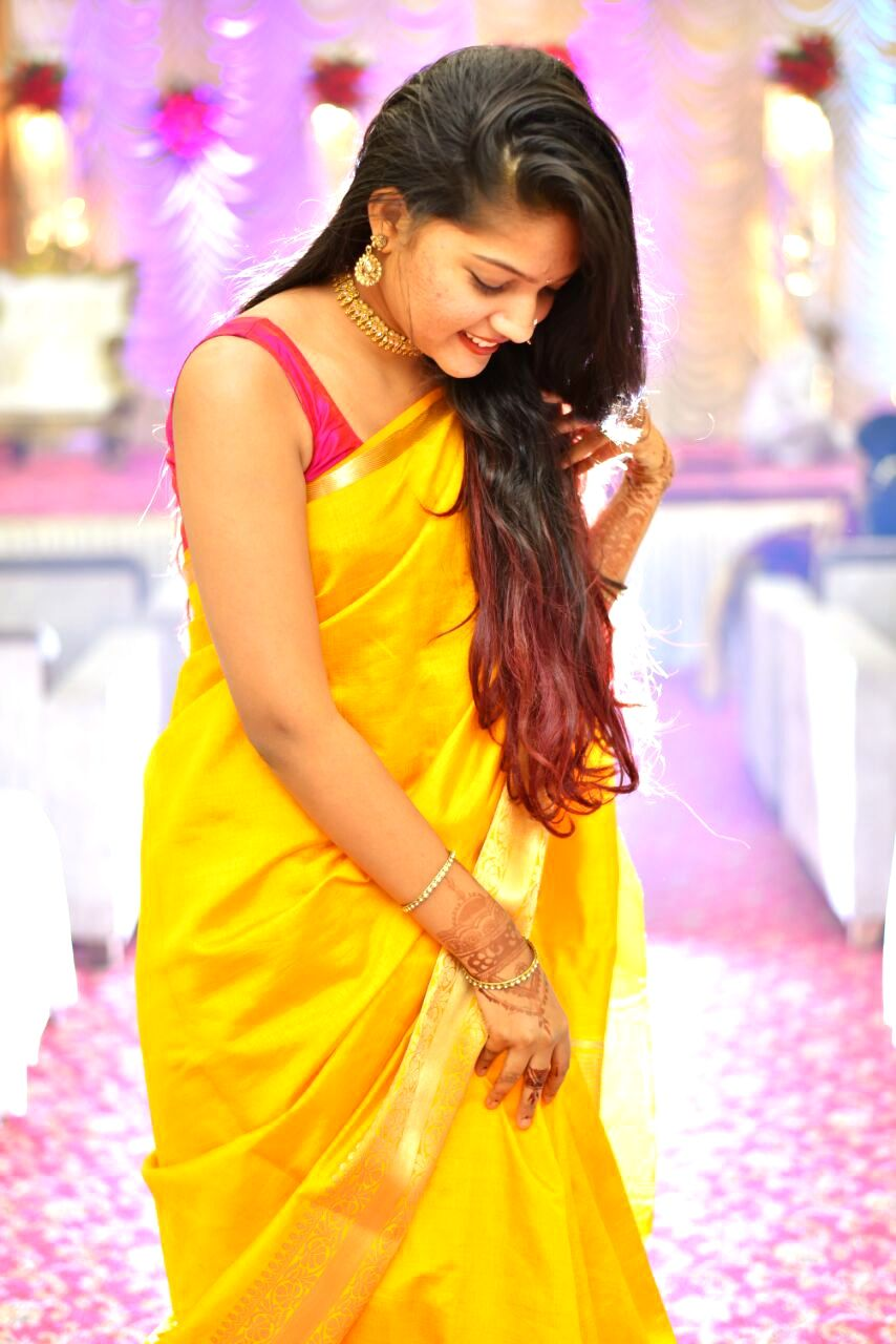361c31b238e659 Riddhi Vartak adores a yellow saree with a contrasting pink sleeveless  blouse. She has styled