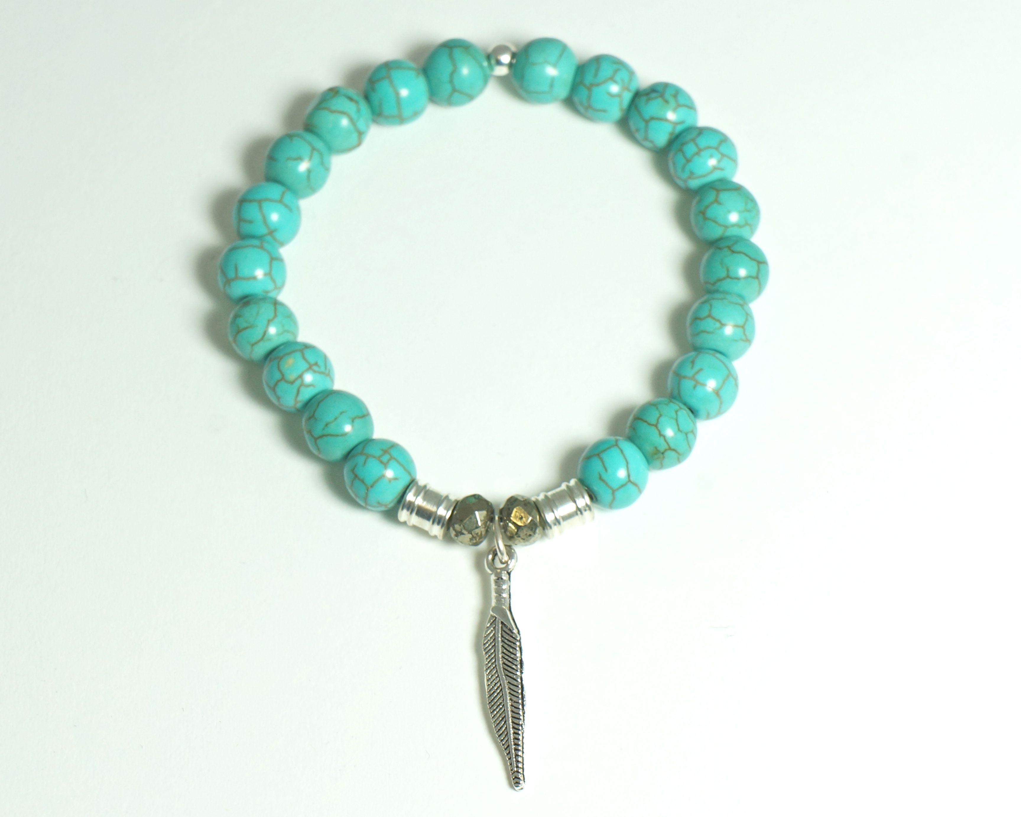 STUNNING HANDCRAFTED Turquoise semi-precious stone bracelet with native indian feather charm only $49.99!! www.tiffanyjazell... contact tiffanyjazelle@gmail.com