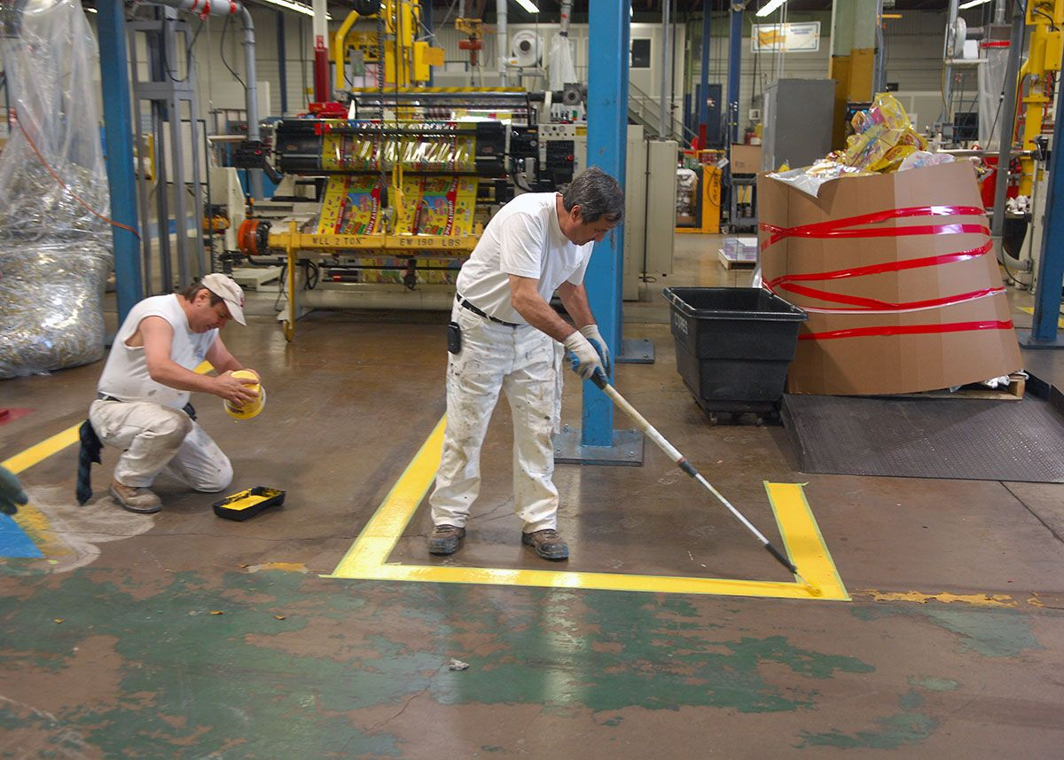 Painting Of Safety Walkway Lines At Sonoco In The Plant