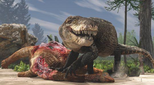 Razanandrongobe feeding on a dinosaur.