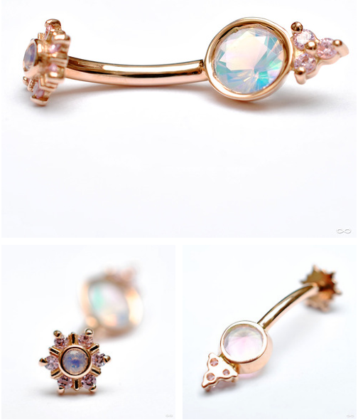 """From Body Vision Los Angeles: Rose-gold curved barbell with a 5mm open-back bezel-set water opal and three 1.5mm prong-set pink CZ accents on bottom, and """"mini Toltec"""" top with a 2mm water opal and 6 1.25mm pink CZs."""