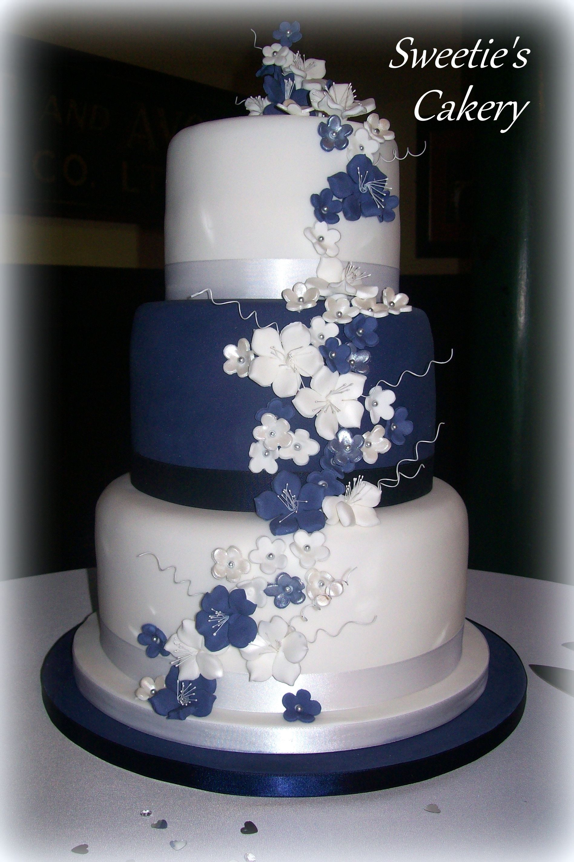 Http Facebook Com Sweetiescakery Navy Blue White And Silver Wedding Cake With Flowers Navy Blue Wedding Cakes Wedding Cake Navy Wedding Cakes Blue