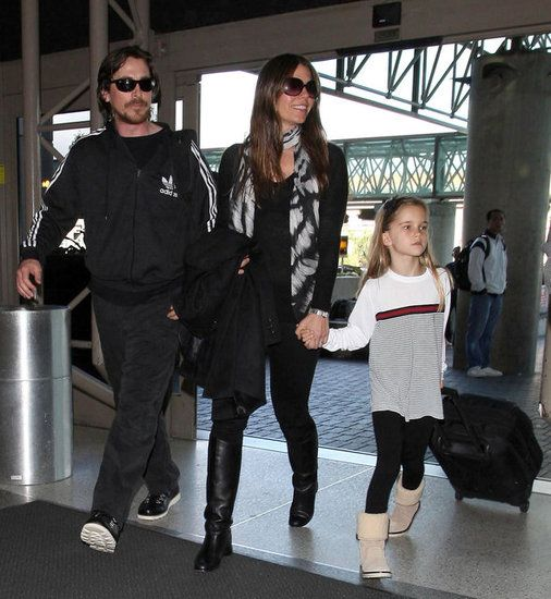 Christian Bale arrived for a flight at LAX on Saturday with his wife, Sibi Blazic, and their daughter, Emmeline.