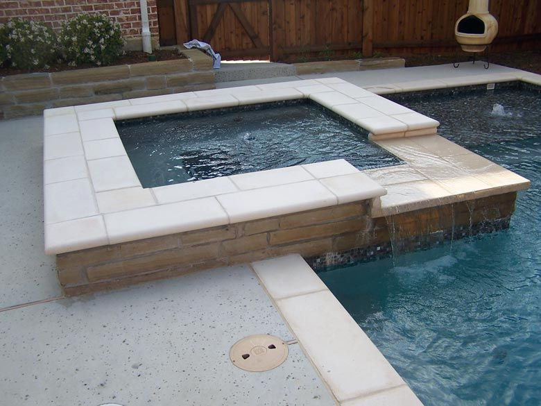 Geometric Spa With Travertine Coping Wrapped In Brick Stone And