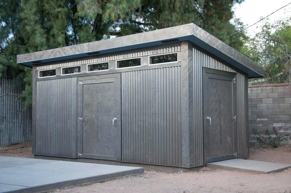 Metal Shed Doors With Corrugated Metal Siding Transom Windows And Secure Doors This Storage Shed Is Built To Last Me Modern Shed Backyard Sheds Building A Shed