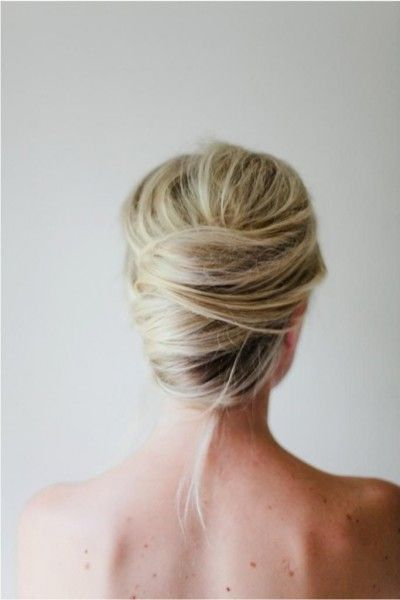 Fall in love with this french twist. | learn how to do these simple & stunning hairstyles here: http://www.mywedding.com/articles/wedding-hairstyles-for-bridesmaids/
