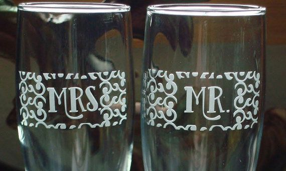 Pair of sand blasted etched champagne toasting flutes with mr and