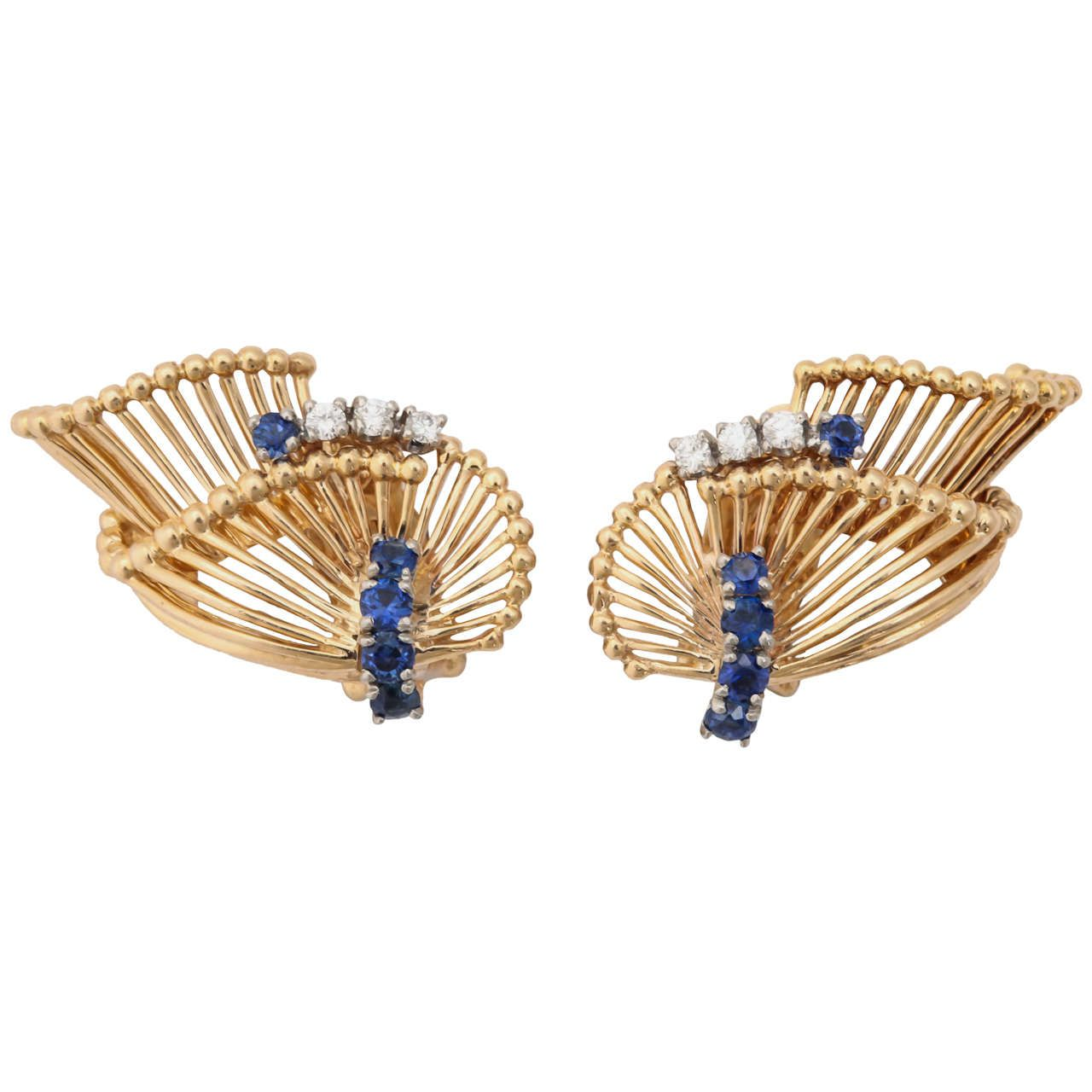 Tiffany & Co. Sapphire Diamond Gold Ear Clips. 14k yellow gold open work stylized leaf earrings, 10 sapphires .50 carat and 6 diamonds 0.20 carat, c 1955