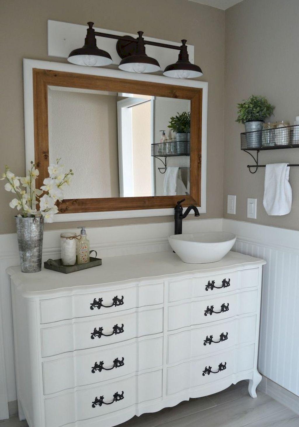 Repurposed dresser as bathroom vanity with offset vessel